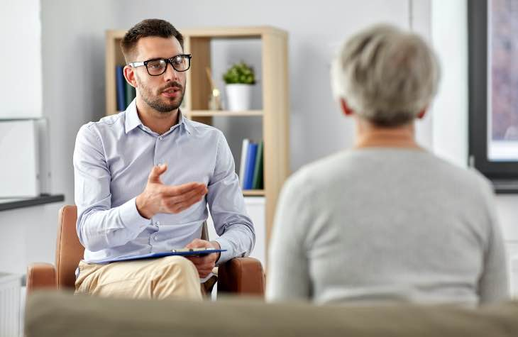 Doctor And Client In Behavioral Therapy At Arizona Rehab
