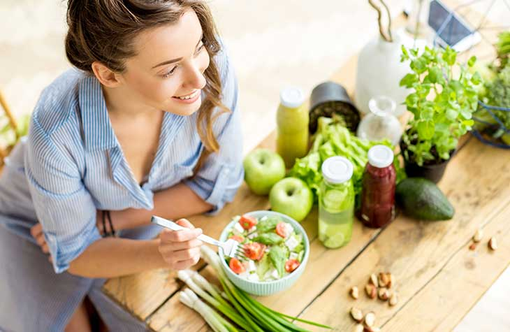A Woman Eating Well After Exercise To Highlight The Physical Benefits Treatment Has For Addiction Recovery