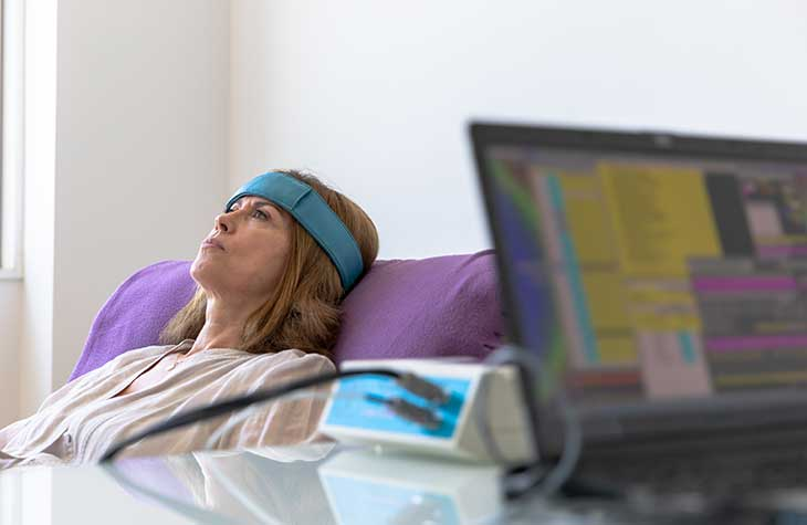 A Woman Receiving Biofeedback A Form Of Experiential Therapy