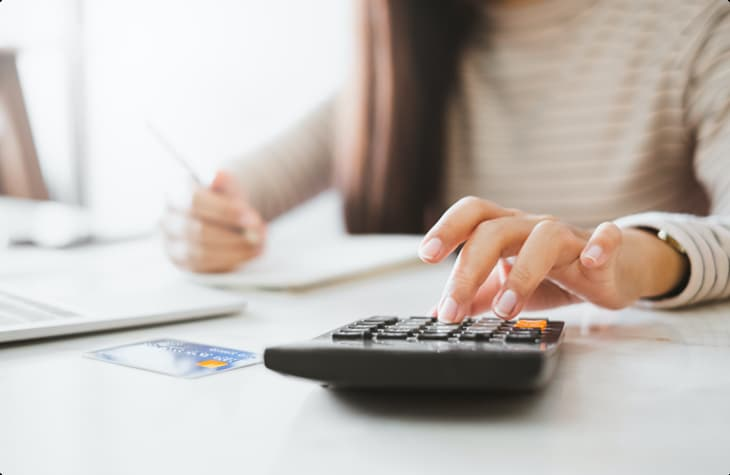 Woman Calculating How She Can Pay For Rehab And Receive Addiction Treatment