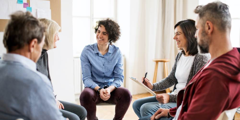 Group Of People In Therapy Together