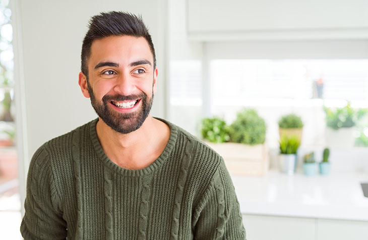 Man Smiling As He Is Better Able To Manage His Addiction Cravings With Exercise