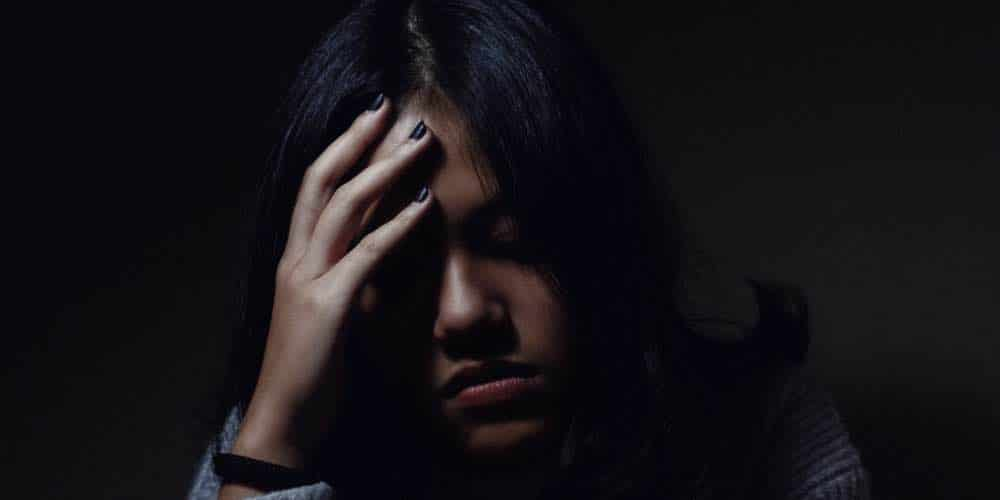 Woman Experiencing Anxiety Along With Addiction