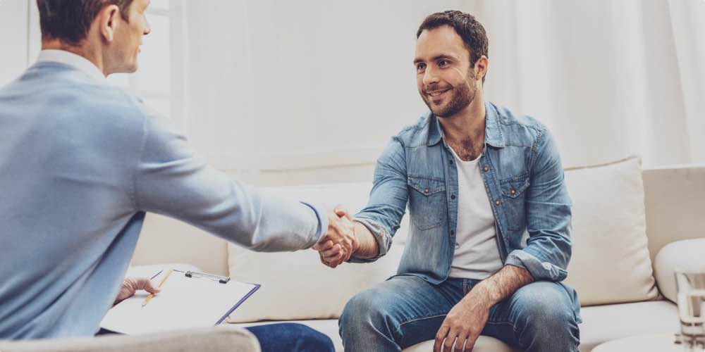 Client Shaking Hands With Therapist To Symbolize The Need For Licenses And Accredidation When Finding The Best Opioid Rehab Center
