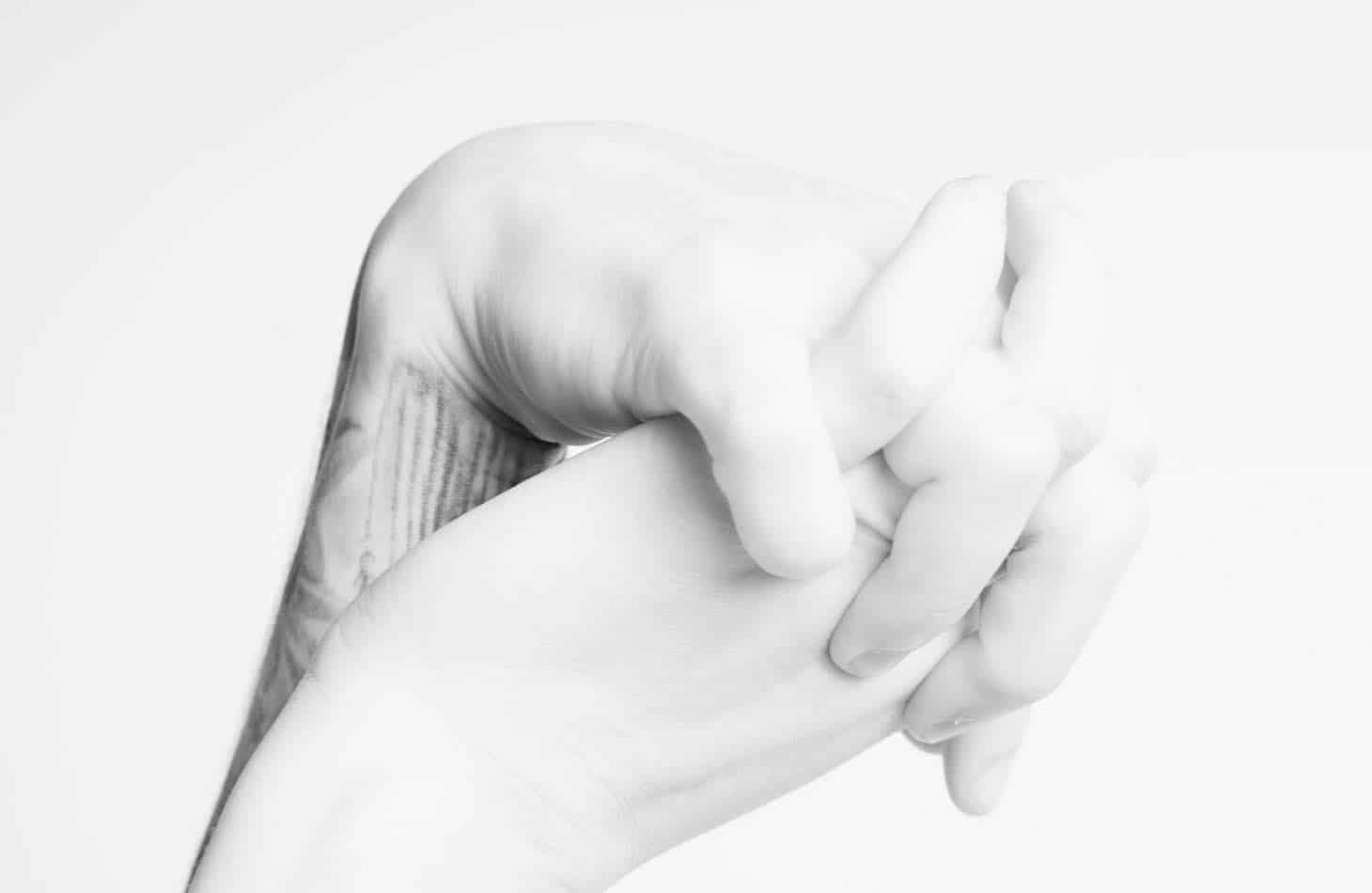 Hands Held Together As Client Withdrawals From Alcohol