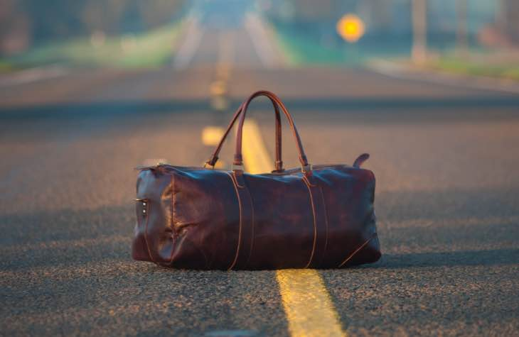Bag In The Road To Symbolize Traveling For Alcohol Rehab