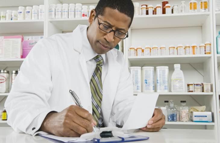 Pharmacist Documenting Medication Prescriptions For Alcohol Addiction