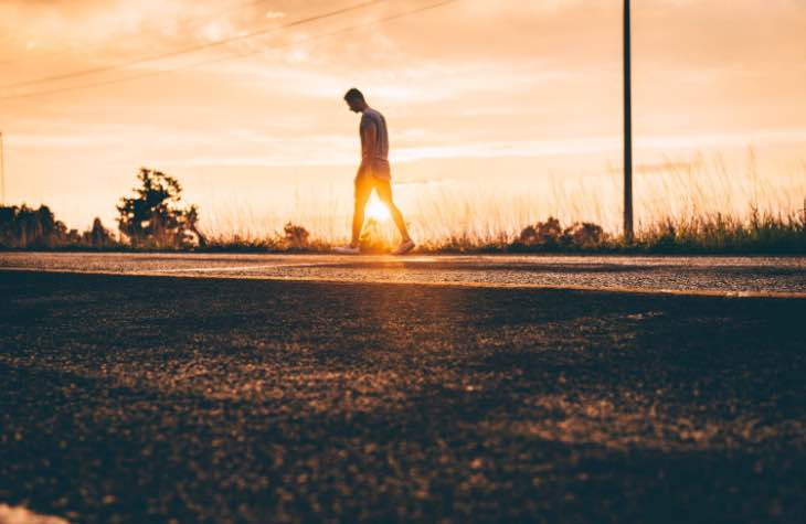 Man Walking On Dirt Path Experiencing The Symptoms Of Alcoholism
