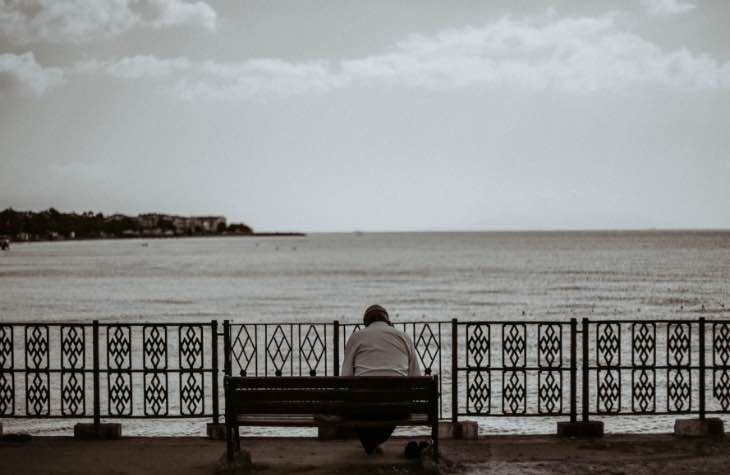 Person On A Bench Exhibiting The Signs Of Alcoholism