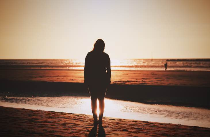 Woman On Beach After Detoxing From Opioids